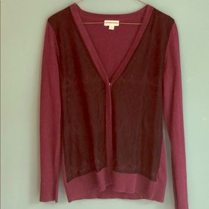 Small, maroon cardigan with black lace detail